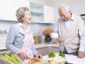 independent living couple cooking in senior living community