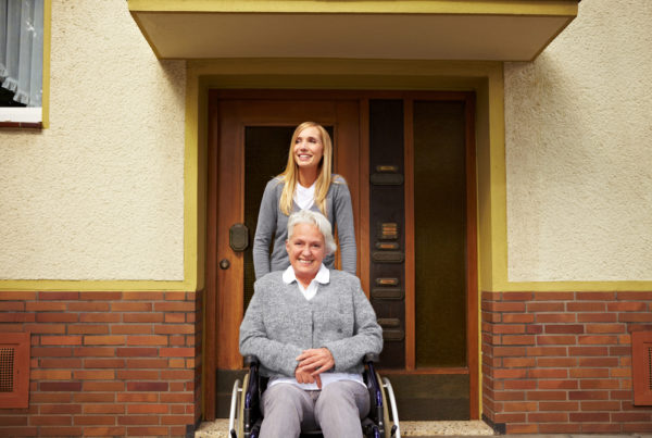 Smiling woman making the most of her assisted living tour
